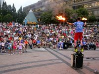 A flame thrower captivates a crowd