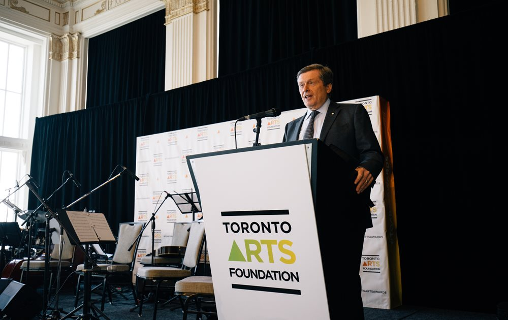 A photo of Mayor Tory at a podium. He is giving a speech.