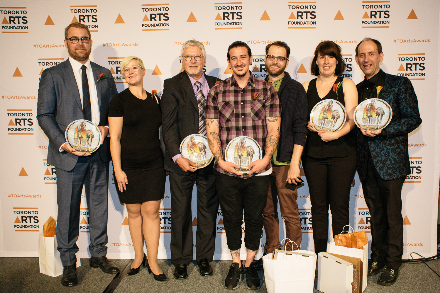 The winners of the 2015 Toronto Arts Foundation Awards. Left to right: Chris Eben, Holly Knowlman, Paul Read, Drex Jancar, Gavin Sheppard, Emilie LeBel, Scott Miller Berry. Photo by Sean Howard.