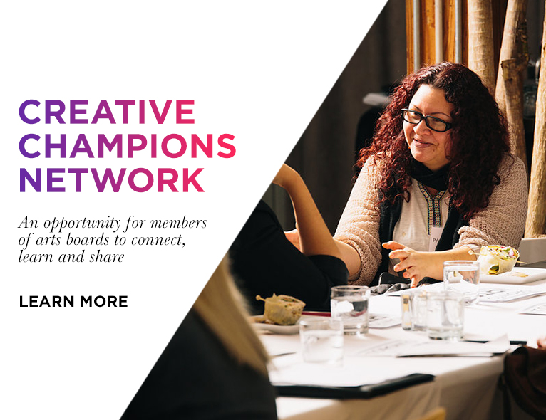 A photo of a woman smiling with deep in conversation. The image has the text 'Creative Champions Network An opportunity for members of arts board to connect, learn and share. Learn more,' on it.